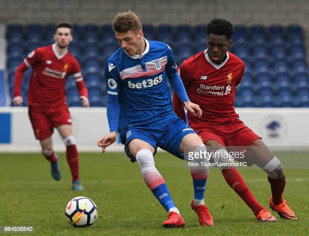 Ovie Ejaria of Liverpool and Joshua Tymon of Stoke City in action during the Liverpool v Stoke City Premier League Cup game at The Swansway Chester...