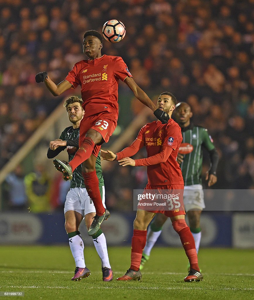 Ovie Ejaria of Liverpool and Kevin Stewart of Liverpool during the Emirates FA Cup Third Round replay match between Plymouth Argyle and Liverpool at Home Park on January 18, 2017 in Plymouth, England.