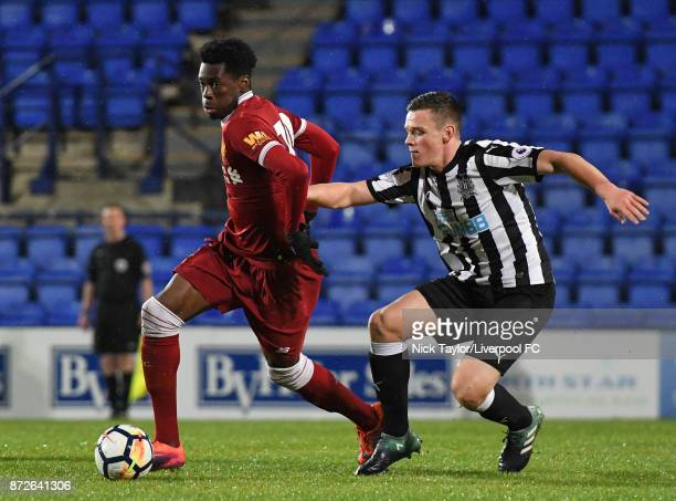 Ovie Ejaria of Liverpool and Owen Bailey of Newcastle United in action during the Premier League International Cup match between Liverpool U23 and...