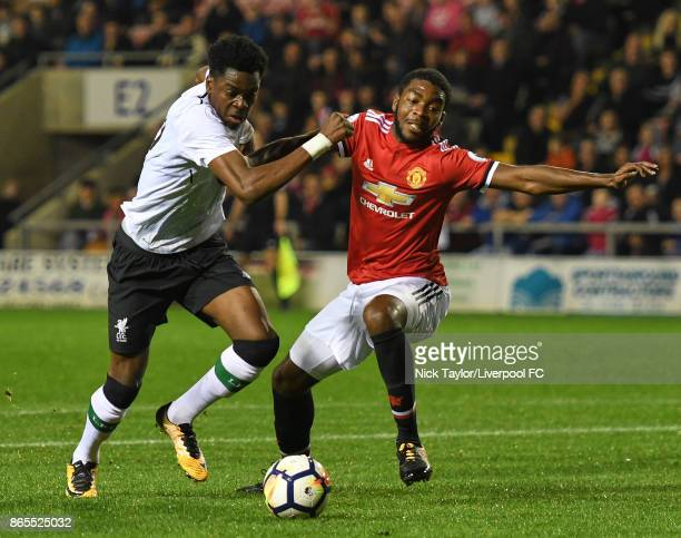 Ovie Ejaria of Liverpool and RoShaun Williams of Manchester United in action during the Manchester United v Liverpool Premier League 2 game at Leigh...