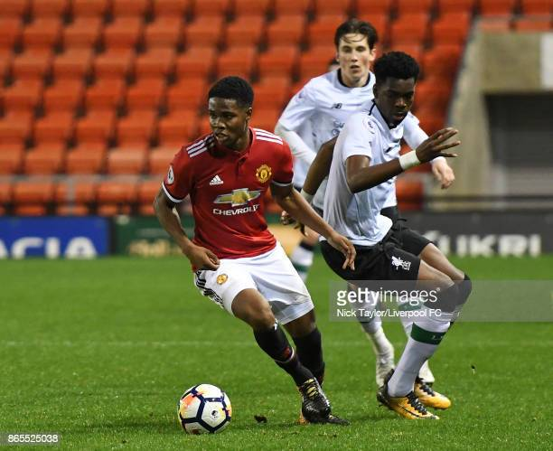 Ovie Ejaria of Liverpool and Tyrell Warren of Manchester United in action during the Manchester United v Liverpool Premier League 2 game at Leigh...