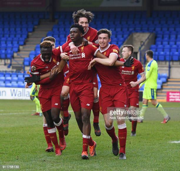Ovie Ejaria of Liverpool celebrates with his team mates after scoring the opening goal during the Premier League 2 match between Liverpool and Derby...