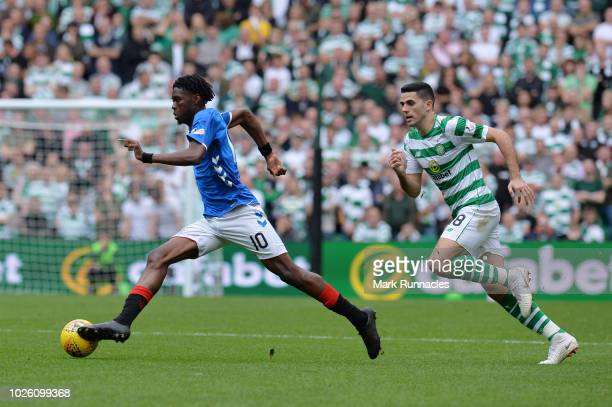 Ovie Ejaria of Rangers and Tomas Rogic of Celtic in action during the Scottish Premier League match between Celtic and Rangers at Celtic Park Stadium...