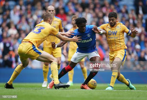 Ovie Ejaria of Rangers vies with Dan Burn of Wigan Athletic during the PreSeason Friendly match between Rangers and Wigan Athletic at Ibrox Stadium...