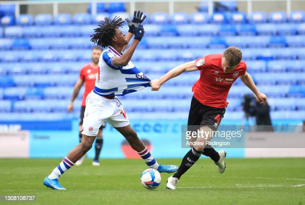 Ovie Ejaria of Reading FC and Rob Dickie of Queens Park Rangers battle for the ball during the Sky Bet Championship match between Reading and Queens...