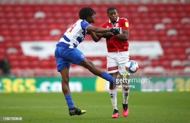 Ovie Ejaria of Reading FC battles for possession with Anfernee Dijksteel of Middlesbrough during the Sky Bet Championship match between Middlesbrough...