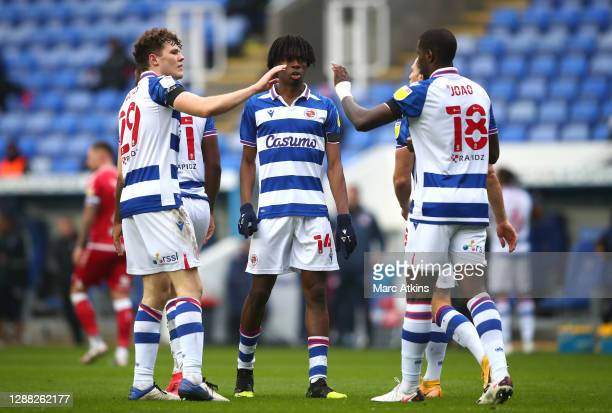 Ovie Ejaria of Reading FC celebrates after scoring their team's first goal with teammates Lucas Joao and Tom Holmes during the Sky Bet Championship...