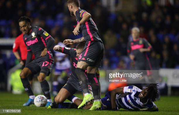Ovie Ejaria of Reading FC is tackled by Kalvin Phillips of Leeds United during the Sky Bet Championship match between Reading and Leeds United at...