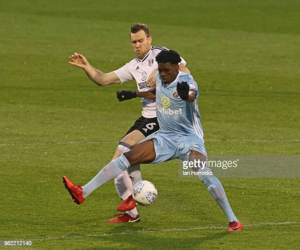 Ovie Ejaria of Sunderland is challenged by Kevin McDonald during the Sky Bet Championship match between Fulham and Sunderland at Craven Cottage on...