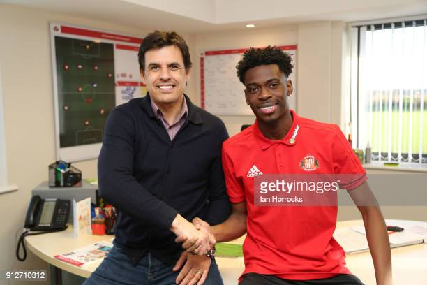 Ovie Ejaria shakes hands with manager Chris Coleman after being unveiled as a Sunderland player at The Academy of Light on January 31 2018 in...