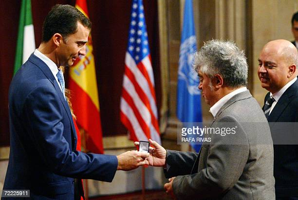 Spainish Crown Prince Felipe gives a decoration to Spanish film director Pedro Almodovar next to his brother and producer Agustin Almodovar , hours...
