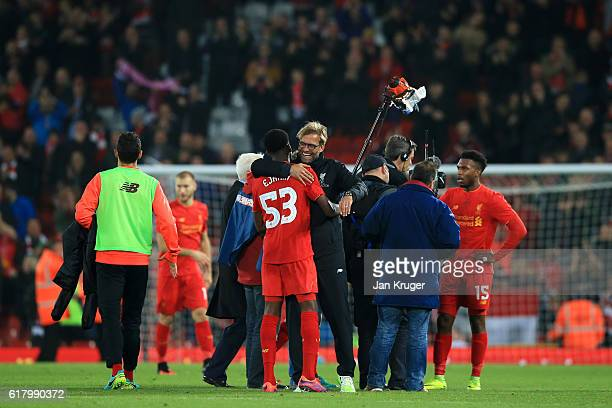 Oviemuno Ejaria of Liverpool and Jurgen Klopp Manager of Liverpool embrace after the final whistle during the EFL Cup fourth round match between...