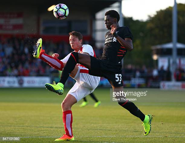 Oviemuno Ejaria of Liverpool gets past Eggert Jonsson of Fleetwood Town during the PreSeason Friendly match between Fleetwood Town and Liverpool at...