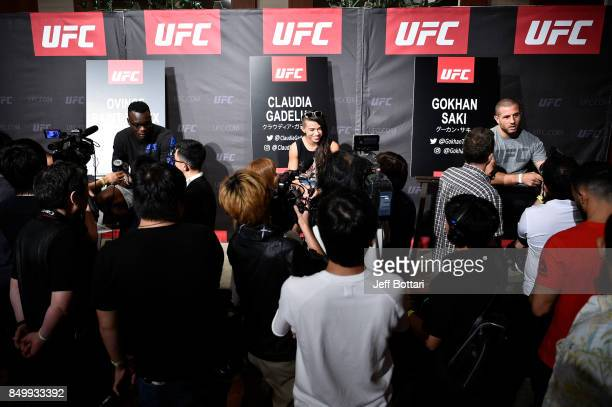 Ovince Saint Preux, Claudia Gadelha of Brazil and Gokhan Saki of Netherlands interacts with the media during the UFC Ultimate Media Day at the Park...
