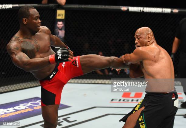 Ovince Saint Preux kicks Marcos Rogerio De Lima of Brazil in their light heavyweight bout during the UFC Fight Night event at Bridgestone Arena on...