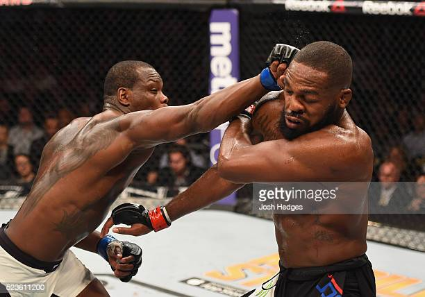 Ovince Saint Preux punches Jon Jones in their interim UFC light heavyweight championship bout during the UFC 197 event inside MGM Grand Garden Arena...