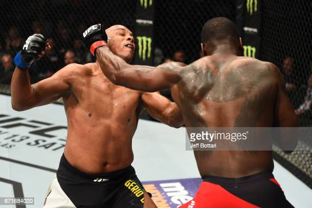 Ovince Saint Preux punches Marcos Rogerio De Lima of Brazil in their light heavyweight bout during the UFC Fight Night event at Bridgestone Arena on...