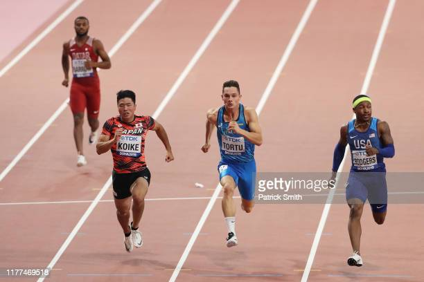 Owaab Barrow of Qatar, Yuki Koike of Japan, Filippo Tortu of Italy and Michael Rodgers of the United States compete in the Men's 100 metres heats...