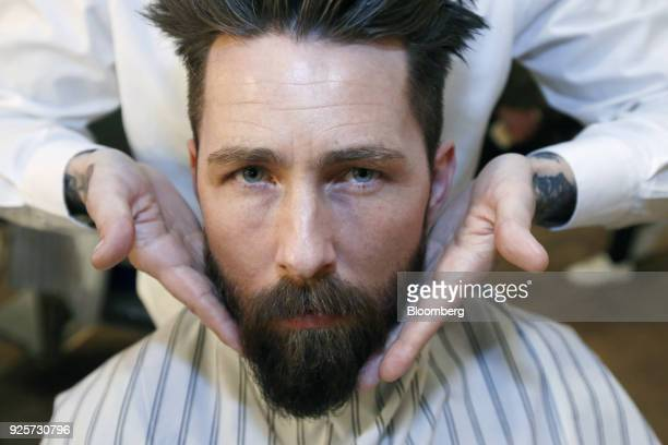 Owain Jones, lifestyle blogger, has his beard groomed during a launch event for House 99, a grooming brand for men created by David Beckham and...