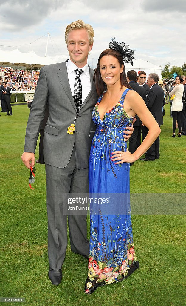 Owain Walbyoff (L) and Natalie Pinkham attend Ladies Day at the Glorious Goodwood Festival at Goodwood on July 29, 2010 in Chichester, England.
