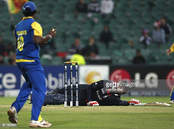 Owais Shah of England stretches for his crease as Ajantha Mendis of Sri Lanka threatens to throw down the stumps during the ICC Champions Trophy...