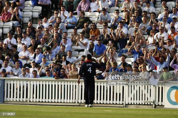 Owais Shah of Middlesex salutes the crowd during the Twenty20 Cup match between Surrey and Middlesex held on June 13, 2003 at the Oval, in London.