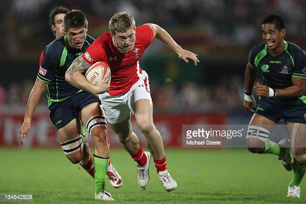 Owen B Williams of Wales powers his way past Jordan Tuapou and Sean McMahon of Australia during the Wales v Australia match on Day Two of the IRB...