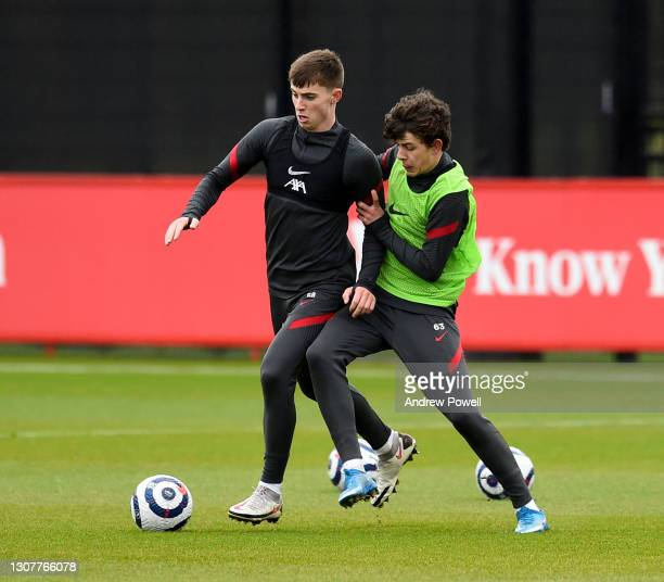 Owen Beck and Ben Woodburn of Liverpool during a training session at AXA Training Centre on March 18, 2021 in Kirkby, England.