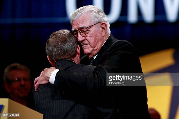 Owen Bieber president of the United Auto Workers union from 19831995 right embraces outgoing UAW president Ron Gettelfinger during the UAW 35th...
