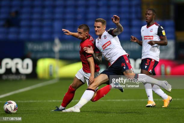 Owen Dale of Crewe Alexandra on the ball with George Taft of Bolton Wanderers during the EFL Trophy match between Bolton Wanderers and Crewe...
