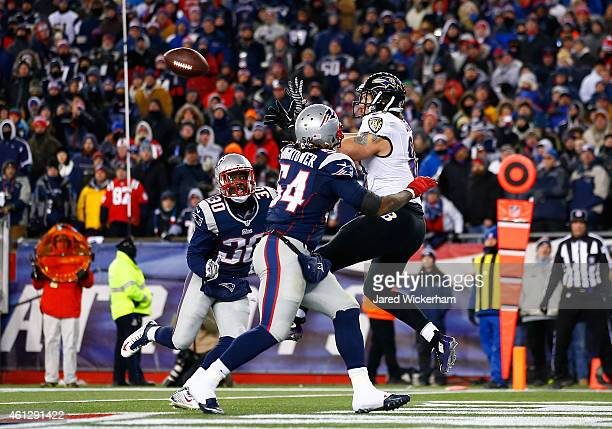 Owen Daniels of the Baltimore Ravens catches a touchdown pass during the second quarter of the 2014 AFC Divisional Playoffs game against the New...
