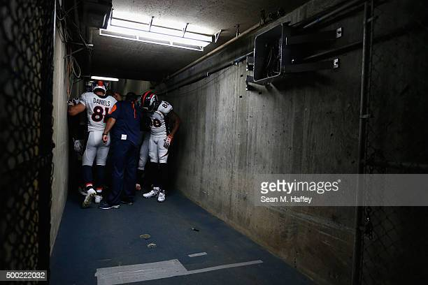 Owen Daniels of the Denver Broncos and Demaryius Thomas of the Denver Broncos pause in a tunnel prior turnover a game against the San Diego Chargers...