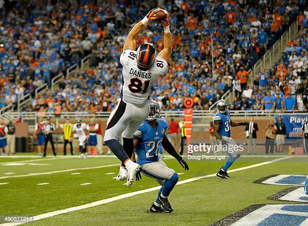 Owen Daniels of the Denver Broncos catches a fourth quarter touchdown while being defended by Quandre Diggs of the Detroit Lions at Ford Field on...