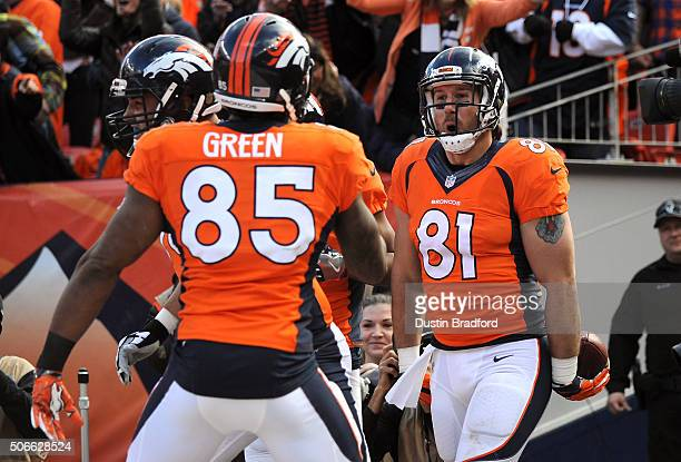 Owen Daniels of the Denver Broncos celebrates after scoring a 12yard touchdown in the second quarter against the New England Patriots in the AFC...