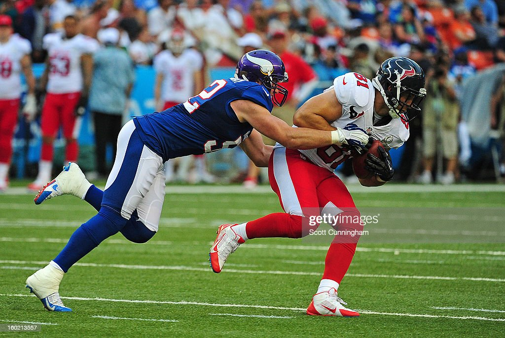 Owen Daniels #81 of the Houston Texans and the AFC is tackled by Chad Greenway #52 of the National Football Conference team during the 2013 Pro Bowl at Aloha Stadium on January 27, 2013 in Honolulu, Hawaii