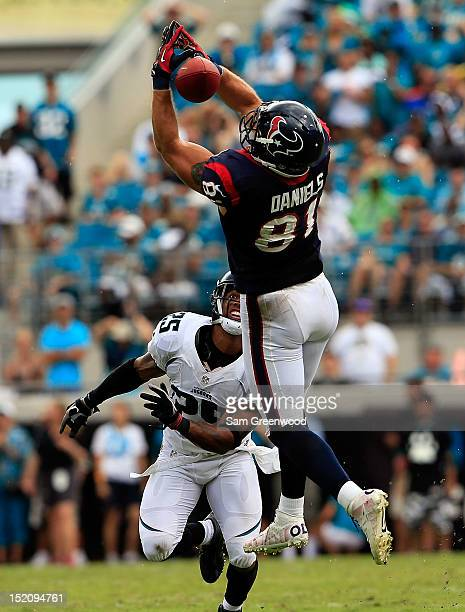 Owen Daniels of the Houston Texans attempts to catch a pass against Dwight Lowery of the Jacksonville Jaguars during the game at EverBank Field on...