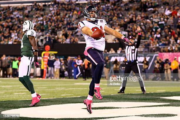 Owen Daniels of the Houston Texans celebrates after he scored a 34yard touchdown reception in the first quarter against Antonio Cromartie of the New...