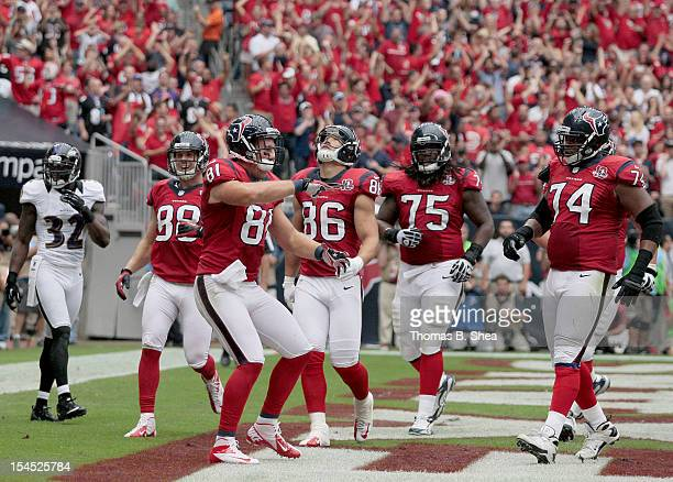 Owen Daniels of the Houston Texans celebrates with teammates after catching a touchdown reception against the Baltimore Ravens on October 21 2012 at...