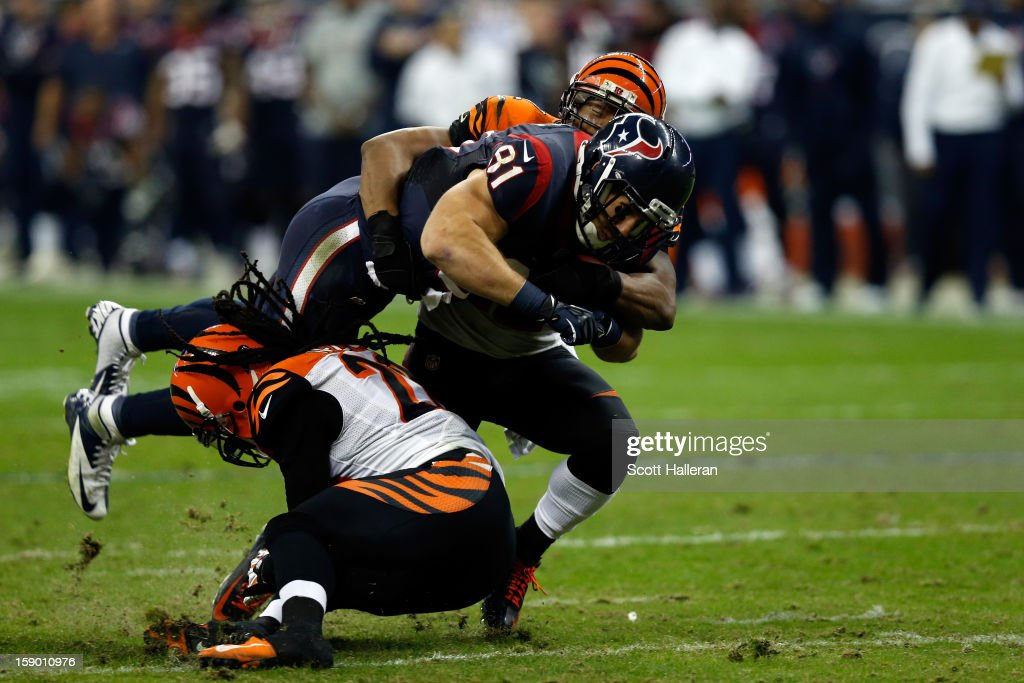 Owen Daniels #81 of the Houston Texans makes a catch against Nate Clements #22 of the Cincinnati Bengals during their AFC Wild Card Playoff Game at Reliant Stadium on January 5, 2013 in Houston, Texas.