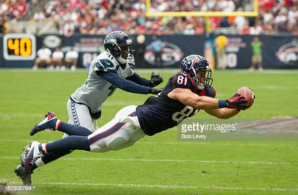 Owen Daniels of the Houston Texans makes a diving catch as he beats Byron Maxwell of the Seattle Seahawks on thie play at Reliant Stadium on...