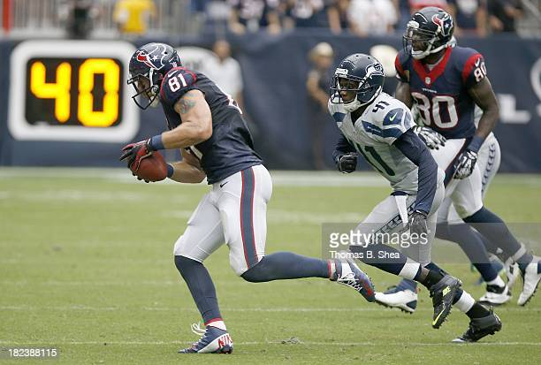 Owen Daniels of the Houston Texans runs after the catch while Byron Maxwell of the Seattle Seahawks gives chase on September 29 2013 at Reliant...