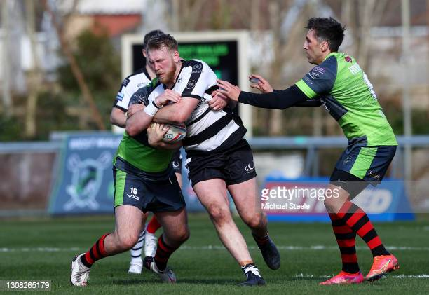 Owen Farnworth of Widnes Vikings is tackled by Gavin Henson of West Wales Raiders during the Betfred Challenge Cup match between West Wales Raiders...