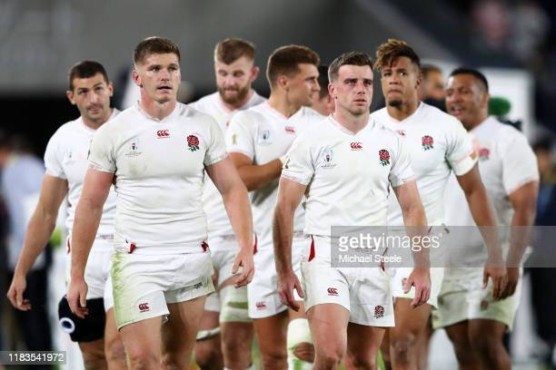 Owen Farrell and George Ford of England look on as they begin a lap of honour during the Rugby World Cup 2019 SemiFinal match between England and New...
