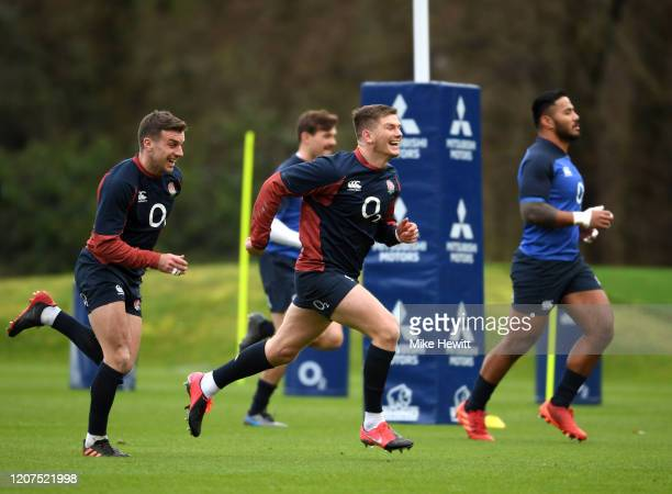 Owen Farrell and George Ford train during an England Media Access Day at Pennyhill Park on February 20 2020 in Bagshot England