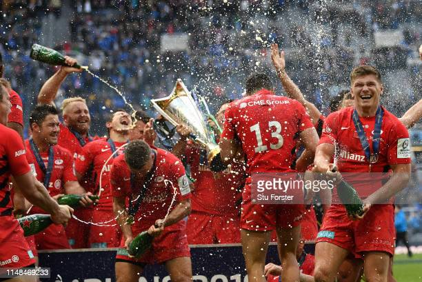 Owen Farrell and his Saracens team mates celebrate with champagne after the Champions Cup Final match between Saracens and Leinster at St James Park...