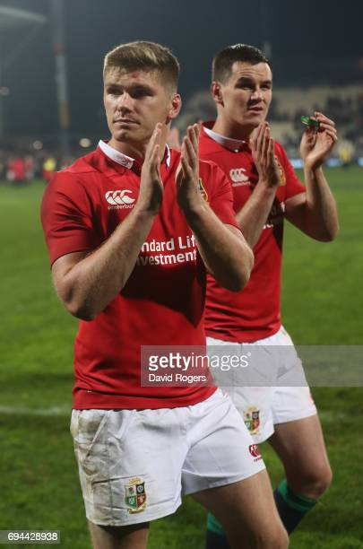 Owen Farrell and Jonathan Sexton of the Lions celebrate their victory during the match between the Crusaders and the British Irish Lions at AMI...
