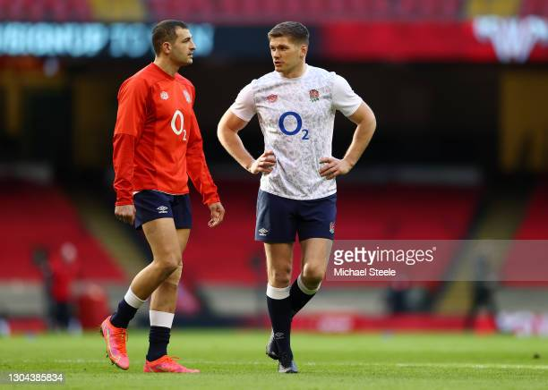 Owen Farrell and Jonny May of England talk during the warm up prior to the Guinness Six Nations match between Wales and England at Principality...