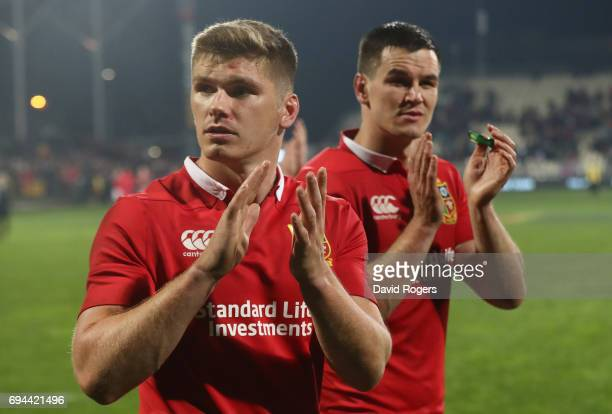 Owen Farrell and Jonny Sexton of the Lions applaud the fans following their team's 123 victory during the 2017 British Irish Lions tour match between...