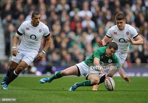 Owen Farrell and Luther Burrell of England and Jonny Sexton of Ireland during the RBS 6 Nations match between England and Ireland at Twickenham...