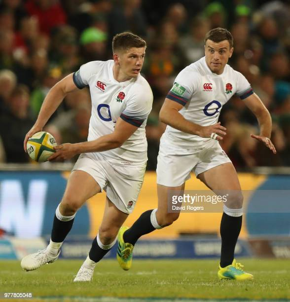 Owen Farrell breaks with the ball as George Ford adds support during the second test match between South Africa and England at Toyota Stadium on June...